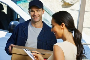 Courier Delivering Parcel to Woman